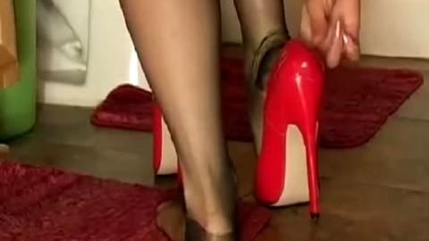 Fantastic lady in pantyhose stockings trying out her brand new sexy red high heel shoes