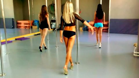 Spectacular pole dancers in hot outfits showing their incredible skills and attractive feet