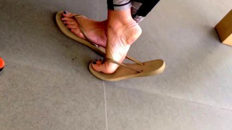 Amateur girl showing her incredible soft feet in flip flops in public
