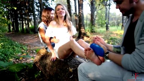 Blonde Russian teenage girl gets sandwiched and tickled by a horny amateur couple in the forest