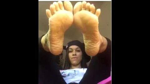 Delicious teenage girl exposing her beautiful wrinkled soles and black feet on her webcam