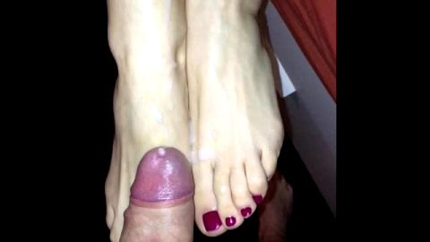 Guy with a big dick cums on amateur babe's sexy feet in POV scene