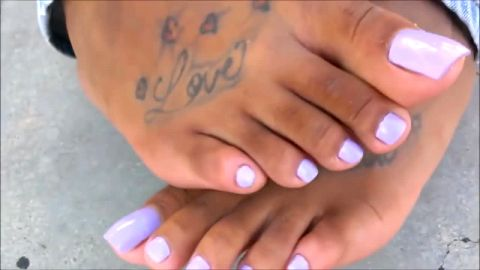 Sexy female student takes her shoes off and reveals hot tattooed feet with pink nail polish