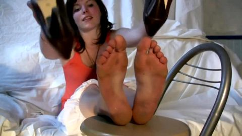 Cute French brunette girl is proud of her dirty feet and soles