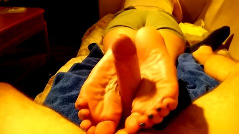 Reverse footjob action provided by a horny amateur girl with beautiful feet