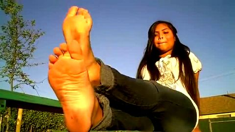 Delicious Latina has fun showing her wonderful dirty naked feet in public