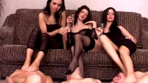Attractive Russian mistresses in hot lingerie get their feet and shoes worshipped by male slaves