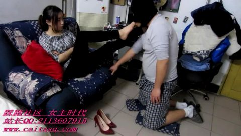 Fat Asian male slave is on his knees licking his Chinese mistress's heels and sexy feet