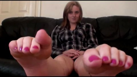 Sexy brunette takes her black shoes and socks off and exposes her naked feet to the camera
