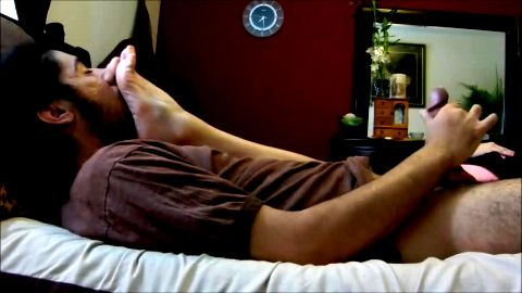 Foot fetish lover jerks off while smelling and sniffing his hot babe's amateur feet in bed