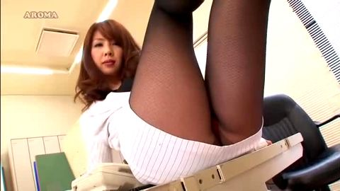 Smoking hot Japanese secretary in black nylon stockings and uniform delivers a footjob at the offce