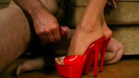 Sensational MILF puts a pair of sexy red platform shoes on and gets jizzed all over her amazing feet
