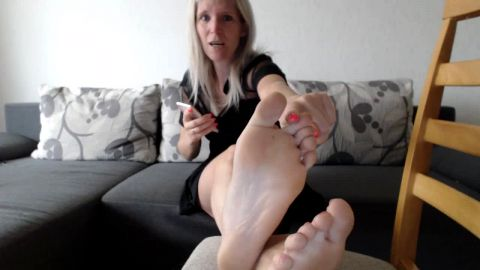 Hot blonde woman with soft mature feet having JOI session on the sofa