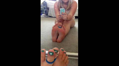 Amateur girl into foot fetish takes a photo of her sexy tied up feet and toes
