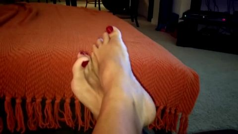 Relaxed lady films her delicious mature feet and toes with red nail polish