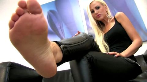 Blonde mature bombshell in hot black outfit takes her attractive shoes off and reveals her feet