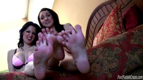 Two stunning brunettes with gorgeous feet participating in a fantastic live JOI action
