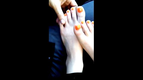 Very horny boyfriend touches his short haired babe's orange toe nails in the car