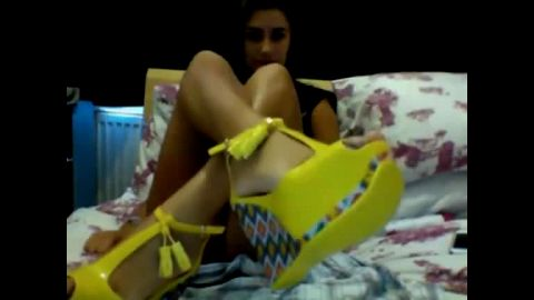 Fabulous teen gets rid of her funky shoes and takes care of them nicely on the webcam