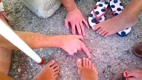 Horny guy gets to choose the most beautiful female feet at the beach