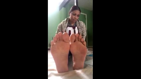 Stunning black girl in jeans has an amazing soles and feet to show