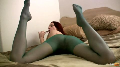 Delicious busty redhead rips off her green nylon stockings and toys herself