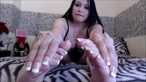 Big tit brunette wearing sexy corset and showing off her long toes nails