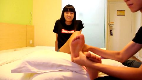 Asian fella wakes up his cute girlfriend from a deep sleep and licks her amazing feet out