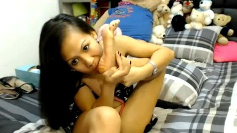 Short Asian girl licking her wonderful feet and toes on the sexcam