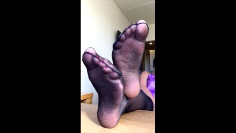 Lazy housewife resting her mature feet in sexy black nylon stockings