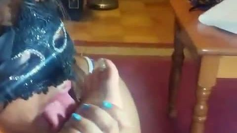 Hottie with a mask worshipping female's attractive feet on the floor