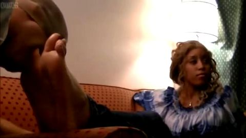 Bossy ebony mistress gets her mature black feet worshipped by a kinky slave