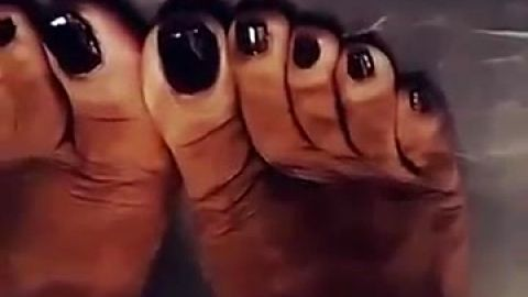 MILF films her beautiful mature black feet with sexy nail polish
