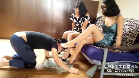 Sexy Asian mistresses getting their fabulous mature feet worshipped by a kinky male slave