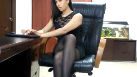 Smoking hot secretary posing at the office in black dress and nylon stockings