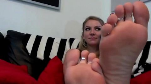 Golden haired girl in sexy lingerie loves wearing toe rings during JOI session