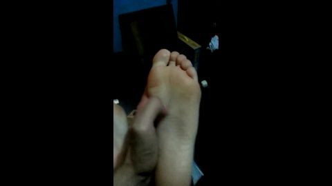 Amateur Latina gets her beautiful college feet tickled in the dark