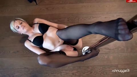 Fantastic German girl in sexy black lingerie giving a great footjob on the floor