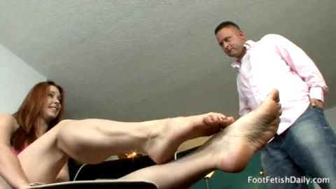 Redhead beauty Melody Jordan fucks a sexy neighbour in perfect foot fetish action