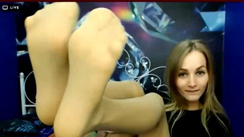 Sexy blonde puts her brand new nylon stockings on her attractive feet and she loves it