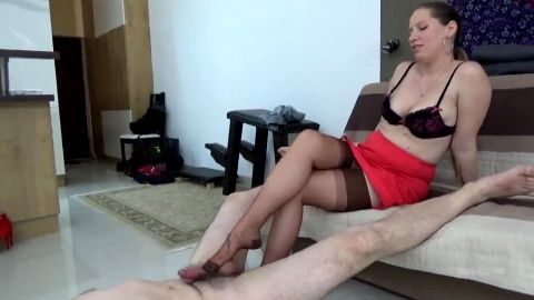 Dominant milf in nylon stockings lady Cruella tortures her slave's cock on the floor