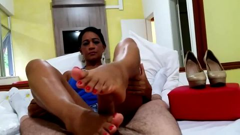 Skilled Latina gives a great footjob in two different positions with her mature feet