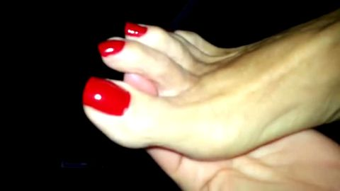 Hot lady shows off her beautiful red toe nails and delicious soles