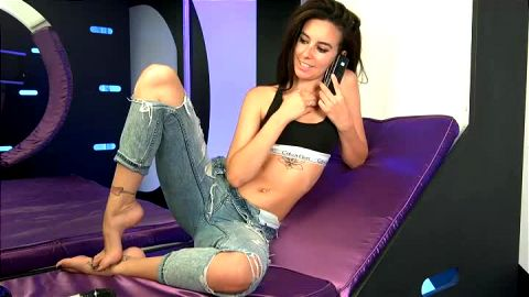 Beautiful babe in sexy jeans Ella Joli shows her assets and pretty feet on the webcam