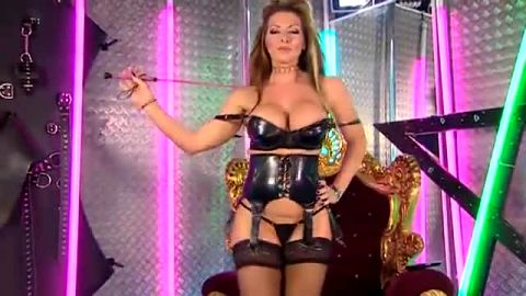 Phone sex goddess with big boobs combines sexy leather lingerie with nylon stockings