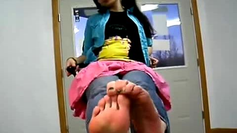 Sweet teenage girl massages her delicious soles and soft feet in solo action
