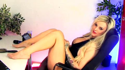 Wonderful tattooed blonde exposes her naked feet during phone sex action