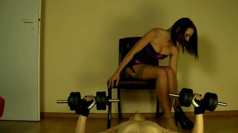 Horny male foot slave lifting weights and sniffing his sexy mistress's feet all at once