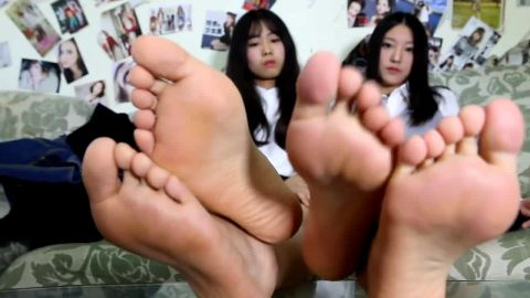 Delicious Asian girls look much sexier after putting nylon stockings on their hot feet