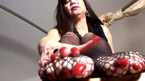 Horny mature woman with huge red toe nails wearing sexy fishnet home alone